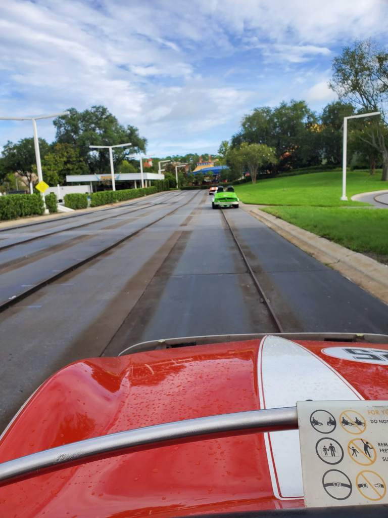 red car on Tomorrowland Speedway in Magic Kingdom
