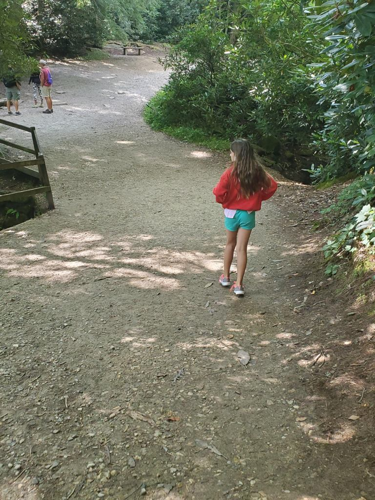 girl standing on Path to Linville Falls