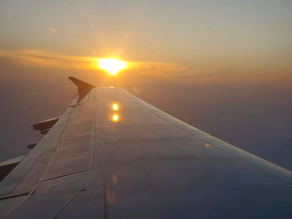 sunrise at 30,000 feet over the Atlantic Ocean.